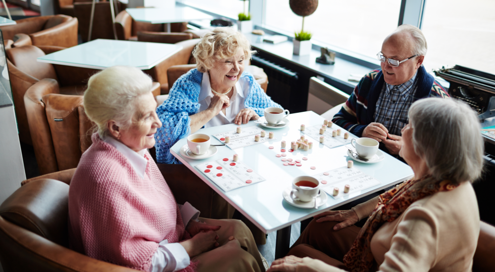 caregiver and old lady smiling