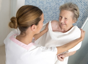 caregiver assisting the old lady taking